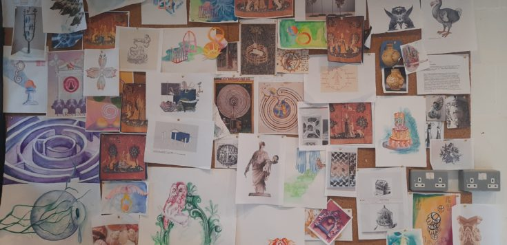 Multiple printed images, sketches and watercolour paintings pinned and slightly overlapping to a cork board in Candida Powell-Williams Studio