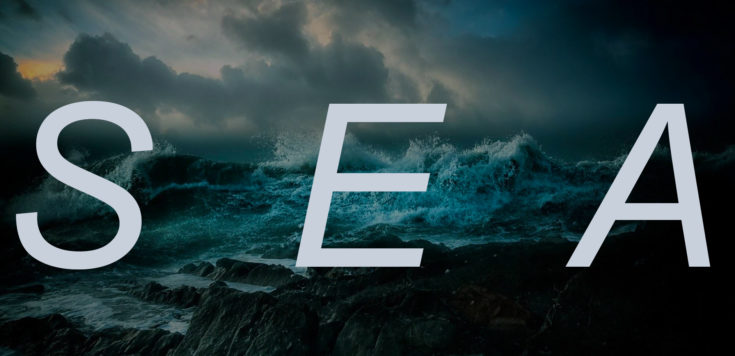 A dark seascape with waves crashing over rocks and dark clouds rolling into the horizon. Overlaid is white text that read 'SEA'